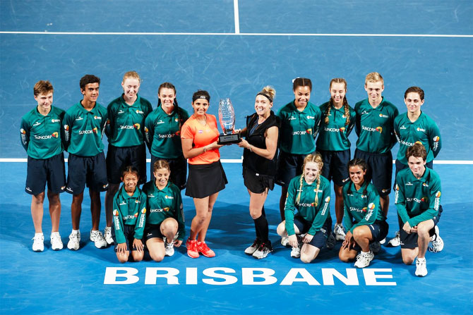 Sania Mirza and Bethanie Mattek-Sands celebrate winning the Brisbane International doubles title on Saturday