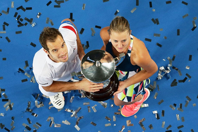 France's Richard Gasquet and Kristina Mladenovic hold the Hopman Trophy after defeating United States' Coco Vandeweghe and Jack Sock in the mixed doubles final of the 2017 Hopman Cup at Perth Arena in Perth on Saturday