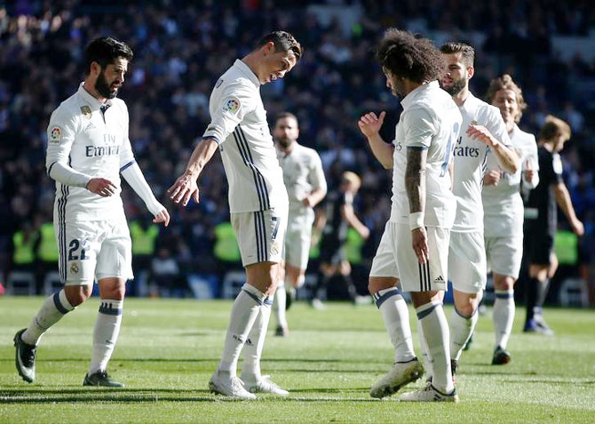 Real Madrid's Cristiano Ronaldo celebrates his goal against Grenada during their La Liga match at the Santiago Bernabeu in Madrid on Saturday