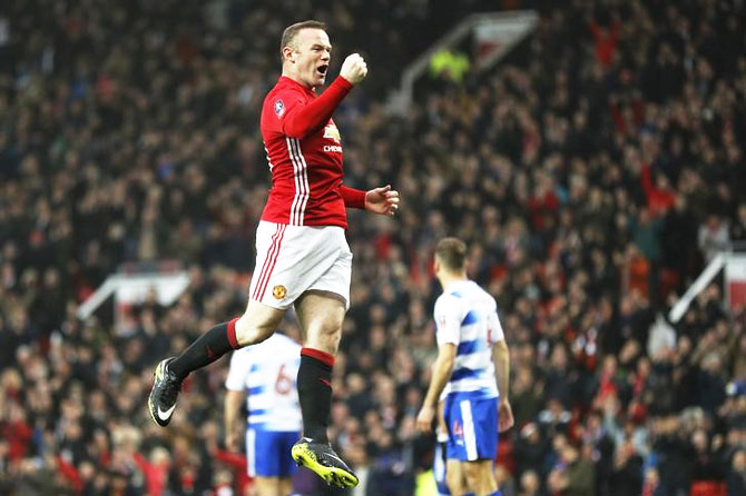 Manchester United's Wayne Rooney celebrates scoring the team's first goal during their FA Cup 3rd round match against Reading FC at Old Trafford in Manchester on Saturday
