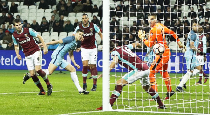 Manchester City's John Stones scores their fifth goal against West Ham United during their FA Cup 3rd round match at the London Stadium on Saturday