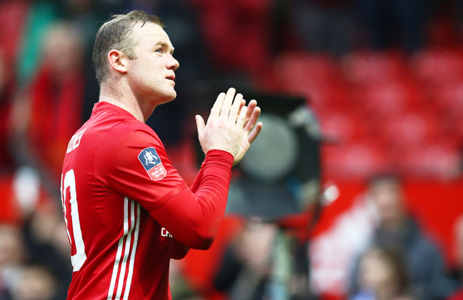 Manchester United's Wayne Rooney applauds supporters following victory over Reading FC in the FA Cup third round match at Old Trafford on Saturday