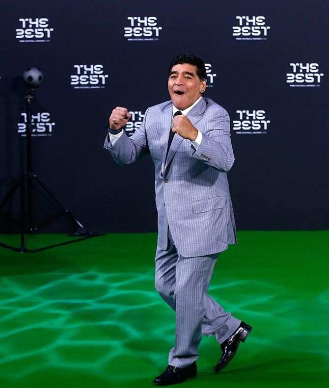 Diego Maradona, one of the greatest footballers of all time, clowns around before the ceremony. Photograph: Arnd Wiegmann/Reuters