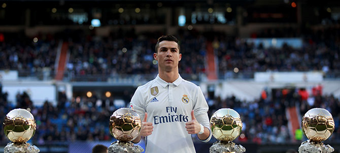 Two days before the event, January 7, Ronaldo poses with his 4 Ballon d'Ors before a game against Granada at the Bernabeu stadium in Madrid. Photograph: Reuters