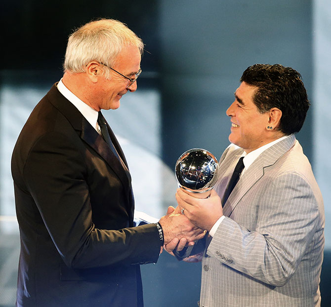 Diego Maradona presents the Manager of the Year Award to Claudio Ranieri whose unfancied Leicester City won the English Premier League last season. Photograph: Ruben Sprich/Reuters