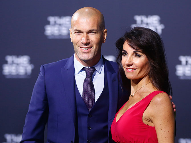 Real Madrid Coach and soccer legend Zinedine Zidane and his wife Veronique arrive at the ceremony. Photograph: Arnd Wiegmann/Reuters