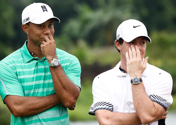 Tiger Woods, left, with Rory McIlroy. Photograph: Lintao Zhang/Getty Images