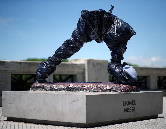 PHOTOS: Lionel Messi statue in Buenos Aires broken in two