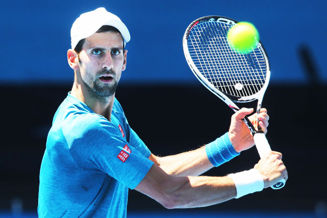 Serbia's Novak Djokovic hits a backhand volley during a practice session on Thursday, ahead of the 2017 Australian Open at Melbourne Park in Melbourne, Australia