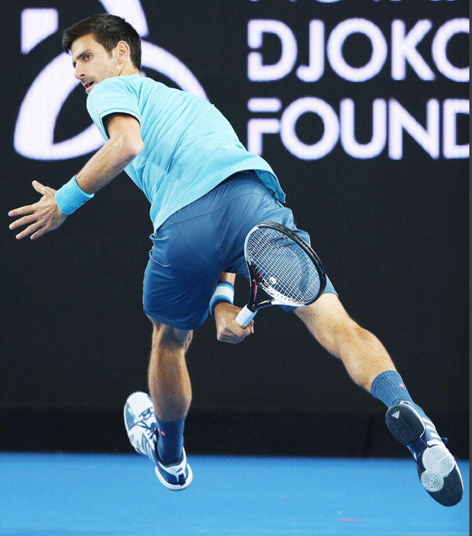 Novak Djokovic hits a forehand through his legs during 'A Night with Novak' at Margaret Court Arena in Melbourne on Wednesday