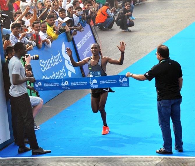 Rediff Sports - Cricket, Indian hockey, Tennis, Football, Chess, Golf - PHOTOS: Simbu, Kitur emerge winners at Mumbai Marathon