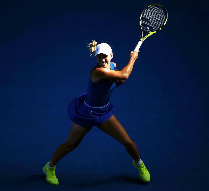 Rediff Sports - Cricket, Indian hockey, Tennis, Football, Chess, Golf - Wozniacki leaves behind White House memories to halt slide
