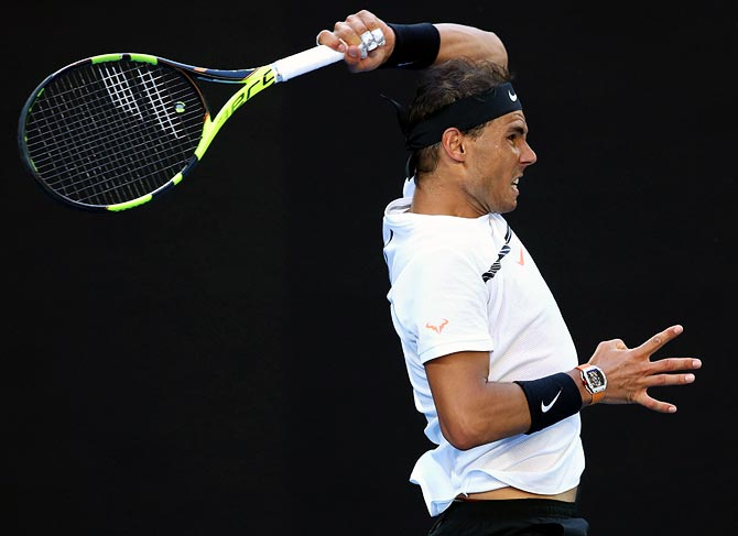 Rediff Sports - Cricket, Indian hockey, Tennis, Football, Chess, Golf - Nadal, Murray move into Barcelona semis