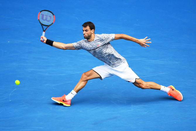 Grigor Dimitrov plays a forehand against Denis Istomin