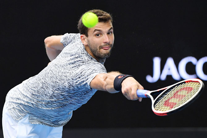 Bulgaria's Grigor Dimitrov plays a backhand in his fourth round match against Uzbekistan's Denis Istomin on day eight of the 2017 Australian Open at Melbourne Park on Monday