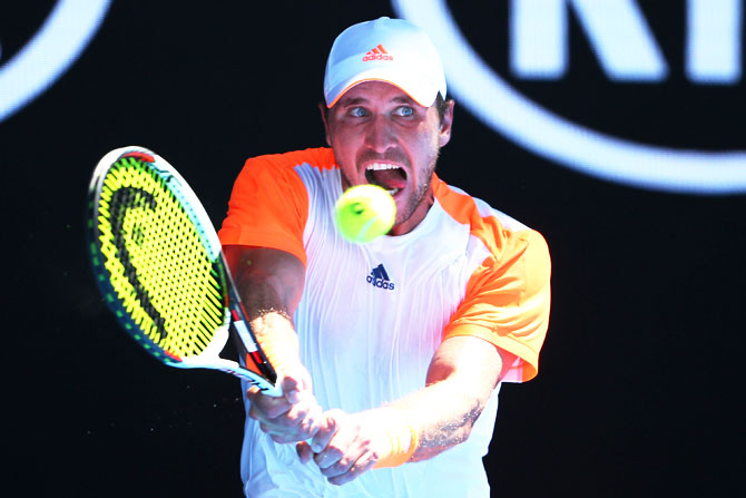 Rediff Sports - Cricket, Indian hockey, Tennis, Football, Chess, Golf - Serve-and-volley tennis rises from the dust in Melbourne