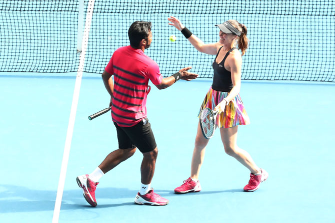 Martina Hingis and Leander Paes celebrate winning their second round mixed-doubles match against Casey Dellacqua and Matt Reid of Australia on day eight of the 2017 Australian Open at Melbourne Park on Monday