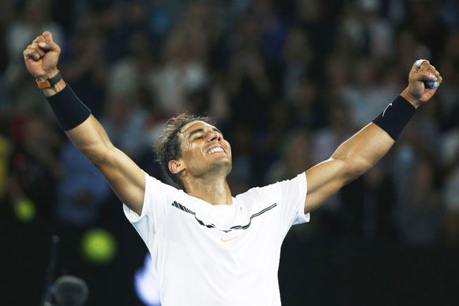 Spain's Rafael Nadal celebrates winning his Australian Open quarter-final against Canada's Milos Raonic at Melbourne Park on Wednesday
