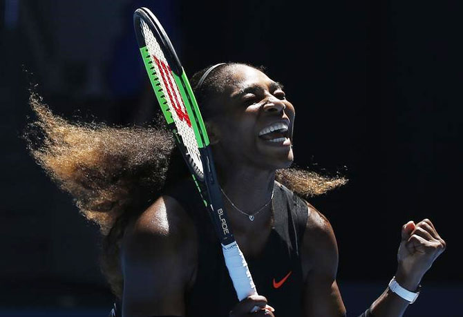 Serena Williams of the US celebrates match point after defeating Britain's Johanna Konta in the Australian Open quarter-final in Melbourne on Wednesday