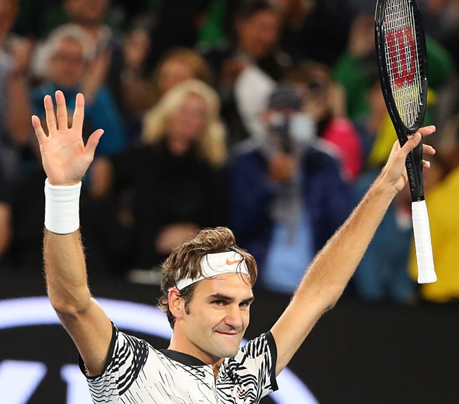 Roger Federer of Switzerland celebrates winning his semi-final match against Stanislas Wawrinka