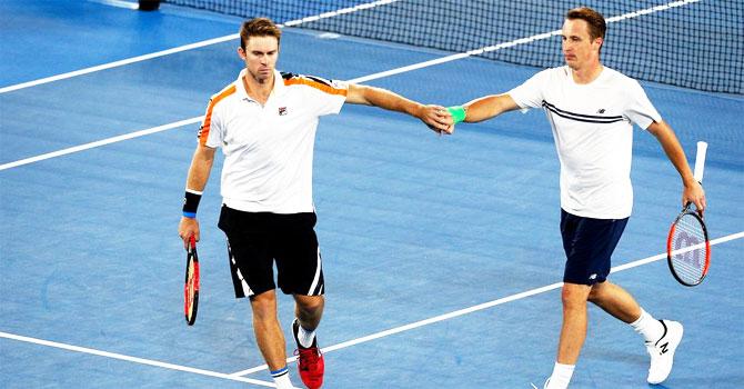 Rediff Sports - Cricket, Indian hockey, Tennis, Football, Chess, Golf - Aus Open: Kontinen-Peers stun Bryan twins to lift men's doubles title