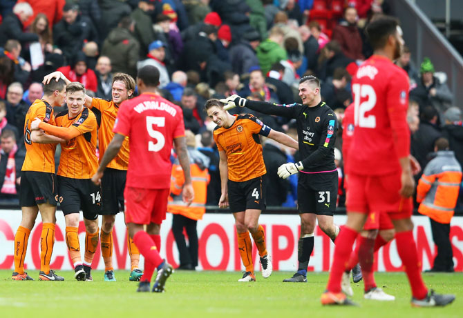 Wolverhampton Wanderers' players celebrate after defeating Liverpool in the Emirates FA Cup fourth round match at Anfield on Saturday
