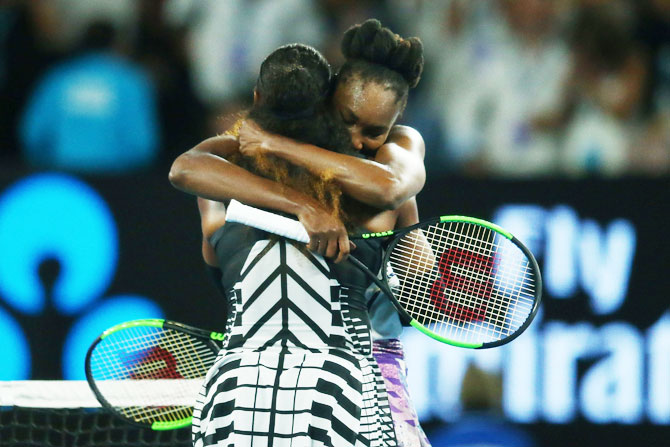 Serena Williams is congratulated sister Venus Williams after winning the Australian Open final on Saturday
