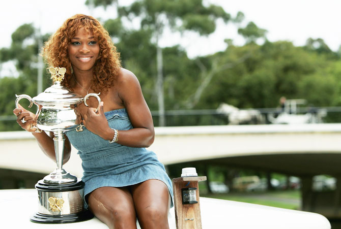 Serena Williams poses onboard a boat on the Yarra River with the Australian Open Championship Trophy after winning the Australian Open Grand Slam final at Melbourne Park on January 29, 2005
