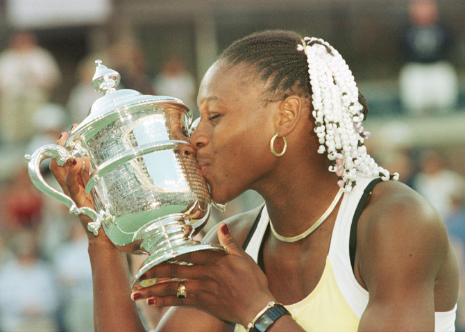 Serena Williams kisses the trophy after defeating Martina Hingis to win the US Open at the USTA National Tennis Center in Flushing Meadows, New York, on 11 Sep 1999