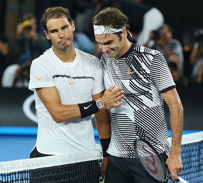 Rafael Nadal and Roger Federer. Photograph: Michael Dodge/Getty Images