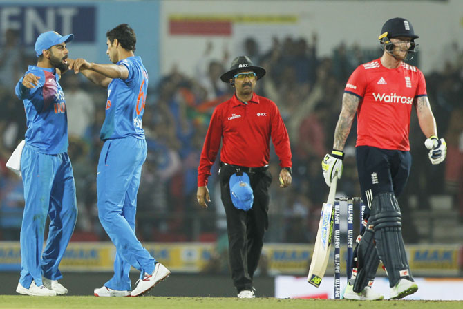 Ashish Nehra and Virat Kohli celebrate Ben Stokes' wicket in a T20 game, January 2017. Photograph: BCCI
