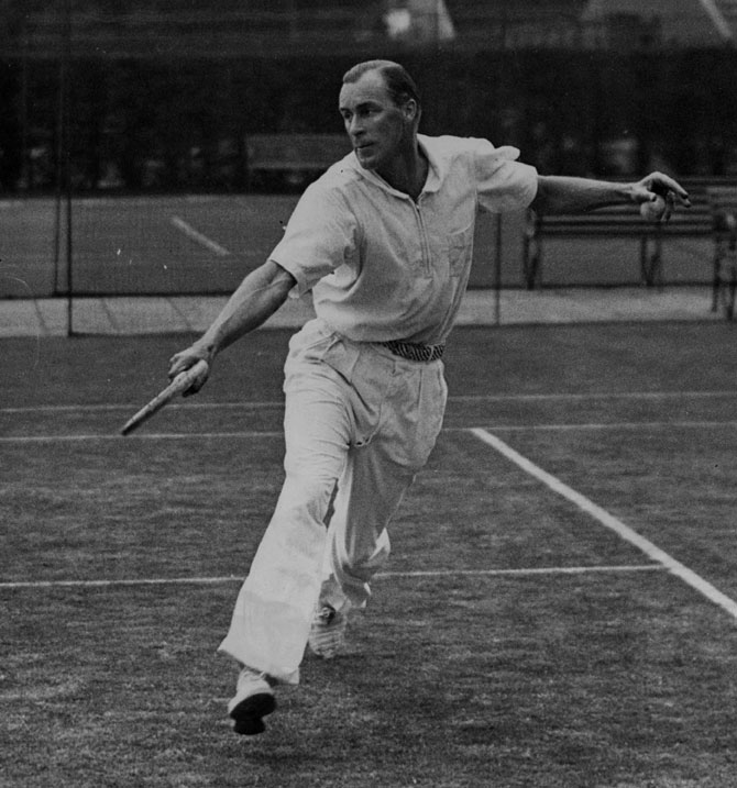 This picture clicked on 18th July 1935 shows 'Big Bill' Tilden, three-time Wimbledon men's singles champion in action