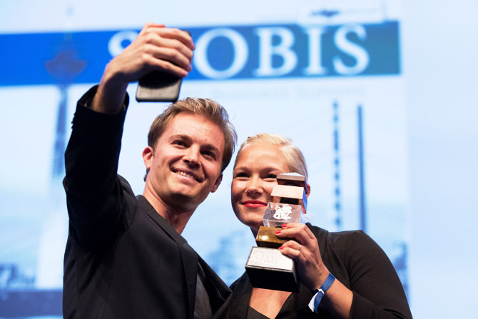 Paralympics gold medalist Vanessa Low and former Formula 1 driver and current world champion Nico Rosberg take a selfie after the former received the 'Keep Fighting Award' during a German business summit, SpoBis, in Duesseldorf, Germany, on Monday. The 'Keep Fighting Award' was launched by Michael Schumacher's family for charitable purposes