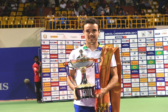 Spain's Roberto Bautista Agut with the Chennai Open trophy on Sunday
