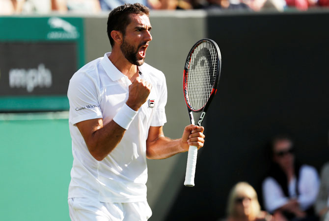 Croatia's Marin Cilic celebrates winning the first round match against Germany's Philipp Kohlschreiber