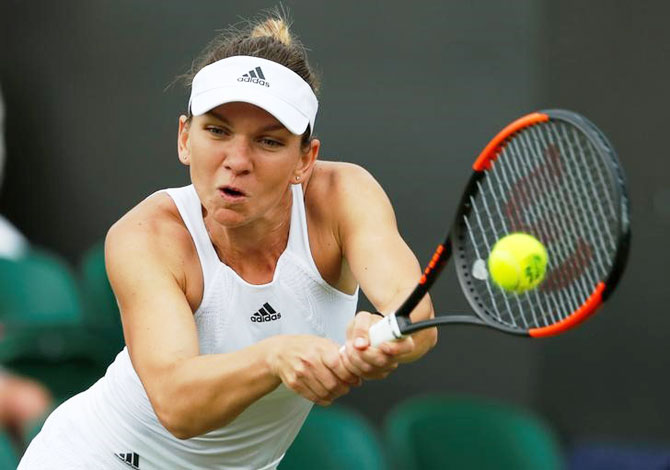Romania's Simona Halep in action during her first round match against New Zealand's Marina Erakovic