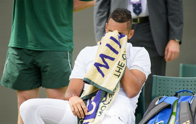 Australia's Nick Kyrgios wears a dejected look during his first round match against Pierre-Hugues Herbert at the Wimbledon Championships in London on Monday