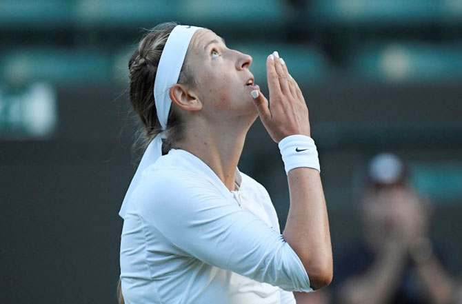 Belarus' Victoria Azarenka celebrates winning her first round match against USA's Catherine Bellis