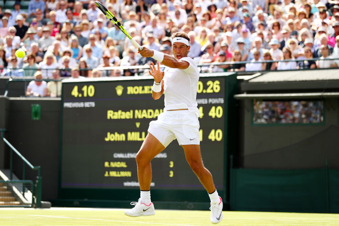 Spain'S Rafael Nadal plays a forehand during his Wimbledon first round singles match against Australia's John Millman at the All England Lawn Tennis and Croquet Club in London on Monday