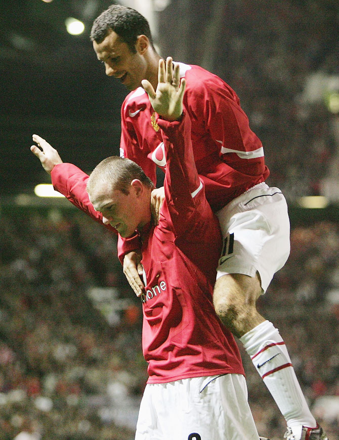 Wayne Rooney of Manchester United celebrates his second goal with teammate Ryan Giggs during the UEFA Champions League Group D match against Fenerbahce SK at Old Trafford on September 28, 2004