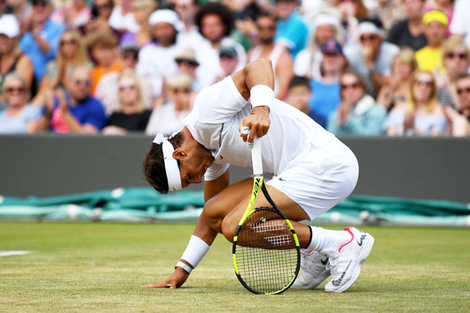 Spain's Rafael Nadal reacts during his fourth round match against Luxembourg's Gilles Muller at Wimbledon on Monday