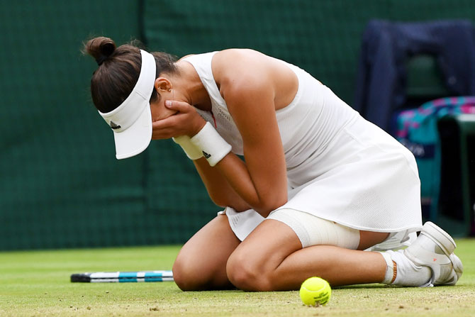 Spain's Garbine Muguruza is ecstatic after winning championship point to claim the Wimbledon title during the final against USA's Venus Williams at the All England Lawn Tennis and Croquet Club at Wimbledon in London on Saturday