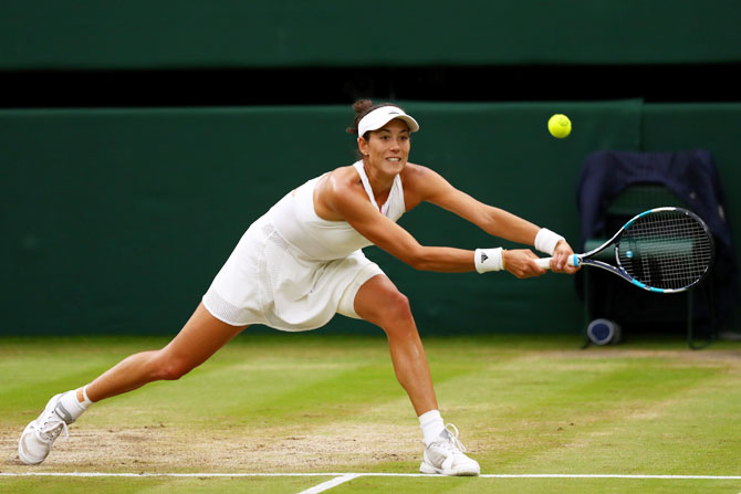 Garbine Muguruza plays a backhand