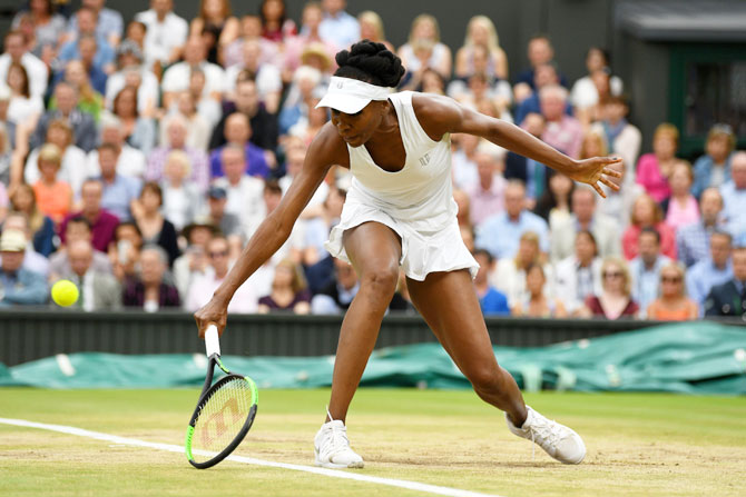 Venus Williams plays a backhand shot