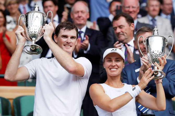 Great Britain's Jamie Murray and Switzerland's Martina Hingis pose as they celebrate with their trophies after winning the Wimbledon mixed doubles final against Finland's Henri Kontinen and Great Britain's Heather Watson on Sunday