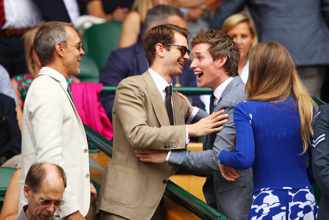 Actors Eddie Redmayne and Andrew Garfield joke from the centre court royal box prior to the men's singles final between Roger Federer and Marin Cilic on Sunday
