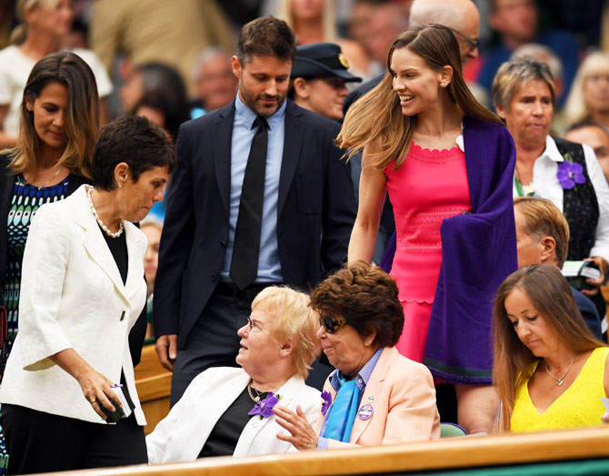 Actress Hilary Swank (centre) and a friend arrive at the centre court royal box prior to the ladies singles final between Venus Williams and Garbine Muguruza on Saturday