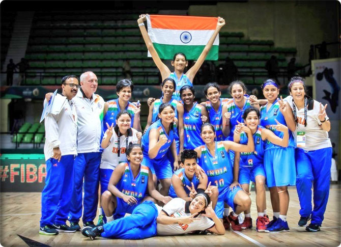 The Indian women's basketball team celebrate after winning the FIBA Women's Asia Cup in Bengaluru on Saturday