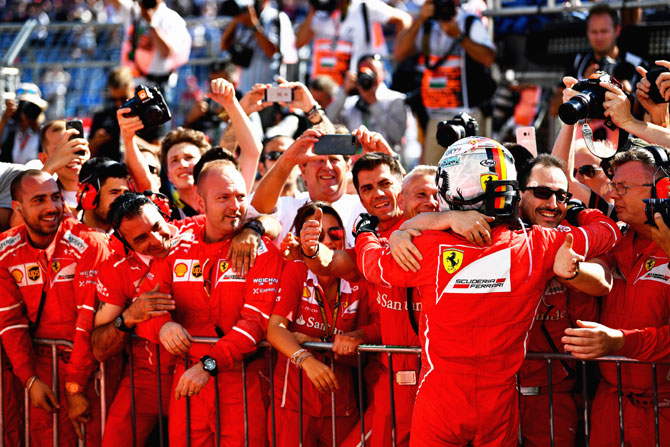 Race winner Sebastian Vettel celebrates his win in parc ferme on Sunday