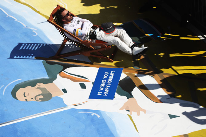 Spain and McLaren Honda's Fernando Alonso takes a seat in parc ferme at Hungaroring